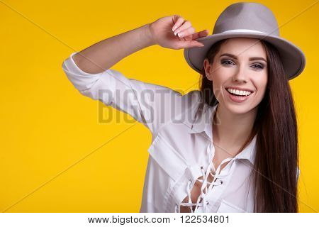 young brunette woman in spring color isolated on yellow background