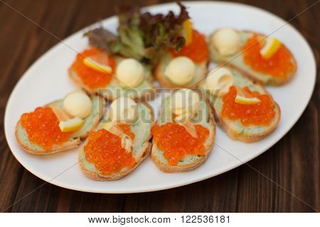 Sandwiches with butter and red salmon caviar. Celebratory appetizer