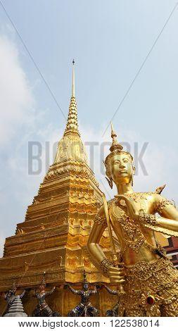 Wat Phra Kaew, golden pagoda and half bird women at landmark of Bangkok, Thailand