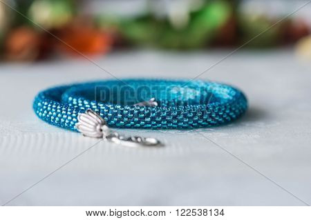 Turquoise Beaded Crochet Necklace On Textile Background