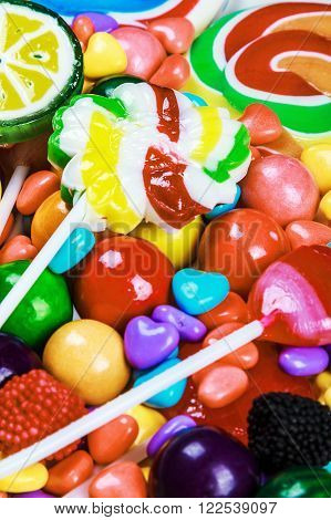 multicolored lollipops candy and chewing gum background. Focus on the top of the frame