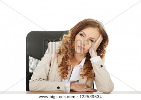 Worried businesswoman at the desk.