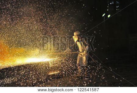 Industrial welder inside of steel plant, cloae up
