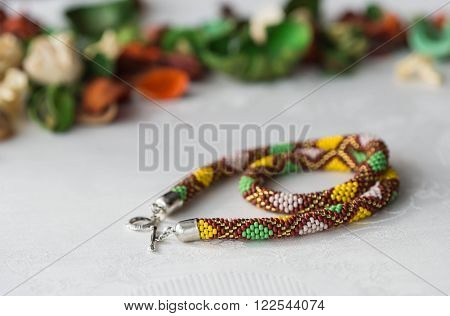 Crochet Beaded Necklace With Rhombus Pattern Of The Textile Background