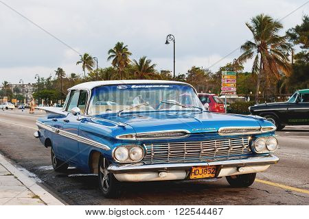 HAVANA CUBA - February 10 2008. Classic oldtimer car parked on street. Most of the Cubans drive cars that were on the road before 1959.