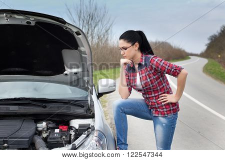 Girl Looking Car With Open Hood
