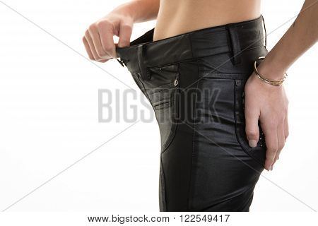 Woman showingt that she lost so much weight that her trousers way oversized now - what a surprise