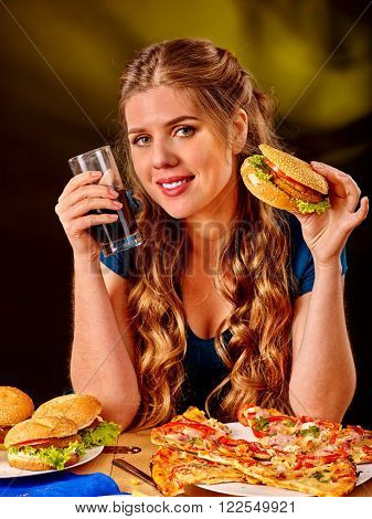 Girl eat fastfood hamburgers with pizza and drink . Fastfood menu.