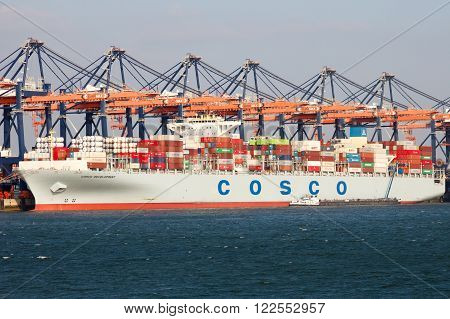 ROTTERDAM NETHERLANDS - MAR 16 2016: Container ship Cosco Development moored at the Euromax container terminal in the Port of Rotterdam.