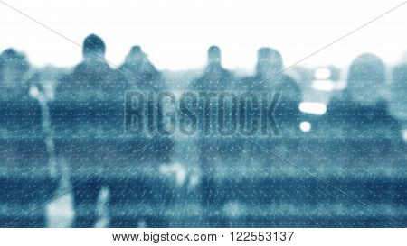 Winter city commuters with snow. Blurred image of people walking on the street. back home after work. Defocused figures of people with snowing effect and frost.