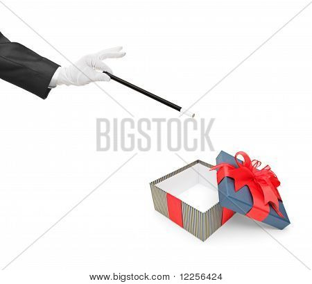 Magician Holding A Magic Wand Over An Empty Gift Box