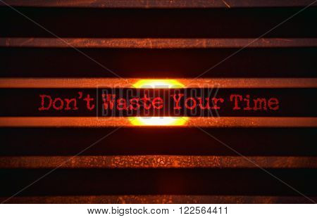Text Do Not Waste Your Time in red and bright sunlight in the background