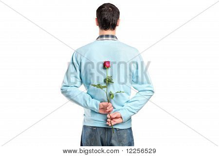 Man Hiding A Flower Behind His Back