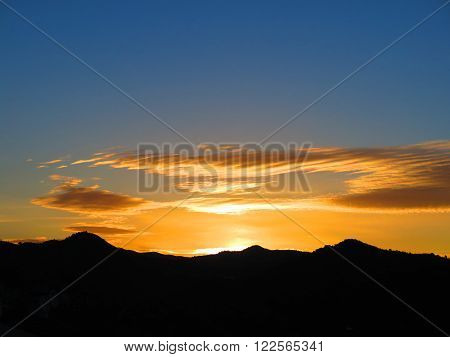Orange Sunrise Over Hills