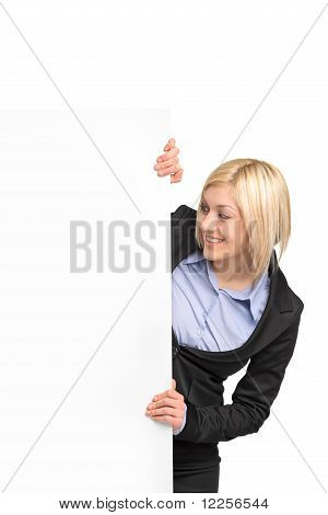Young Blond Businesswoman Looking At White Banner