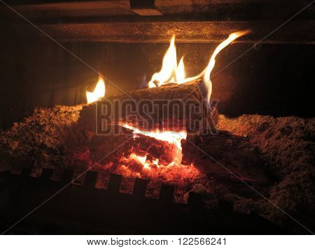 Logs burning bright in a wood burner