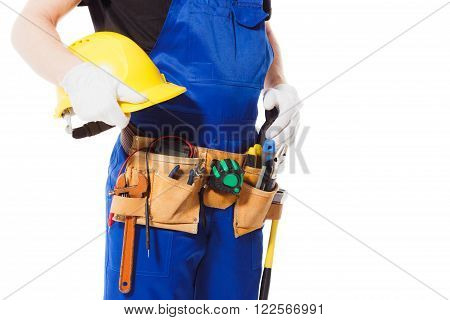 Man builder with belt of different construction tools isolated on the white background