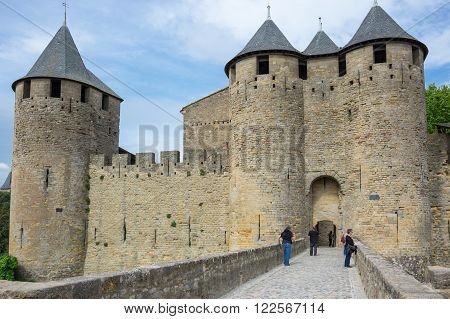 CARCASSONNE FRANCE - MAY 05 2015: Medieval gate to old castle of Carcassonne Languedoc - Roussillon France