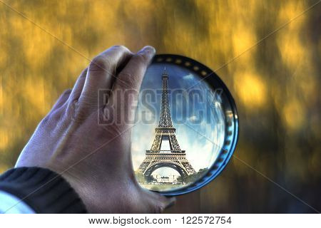 Picture of a Hand hold magnifying glass with souvenir of Eifell tower