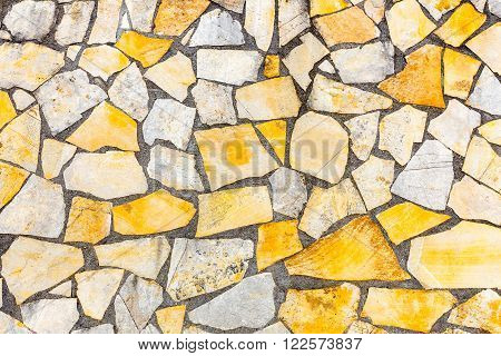 Different shapes of stones brickwork or masonry as background wall
