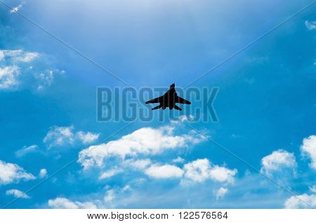 silhouette of flying combat aircraft in the sky