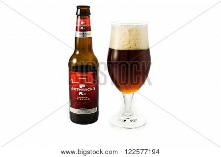 Winneconne WI - 29 January 2015: Bottle of Smithwick's Premium Irish Ale poured in a beer glass. Smithwick's is the oldest Irish brew dating back to 1710.