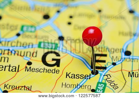 Photo of pinned Kassel on a map of Germany. May be used as illustration for traveling theme.