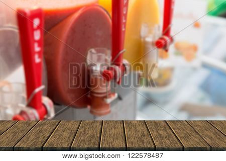fruit juice in slush machine for selling in market (blur background with wood table top for display or montage your product)