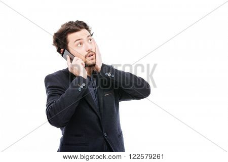 Thoughtful businessman talking on the phone isolated on a white background