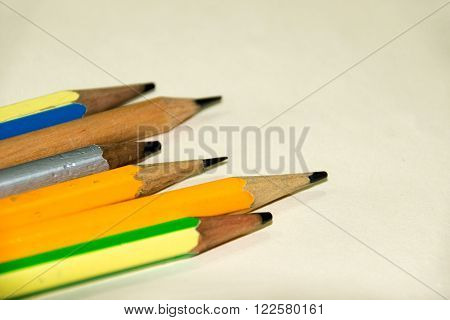 Close up Group Of Pencils on paper