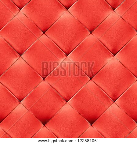 Red genuine leather upholstery background. Luxury pattern.