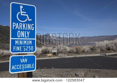 Blue disabled parking only sign at Mono Lake in California