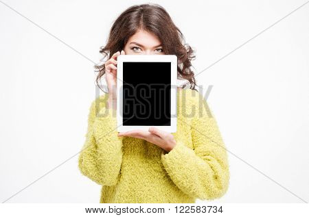 Young woman showing blank tablet computer screen isolated on a white background