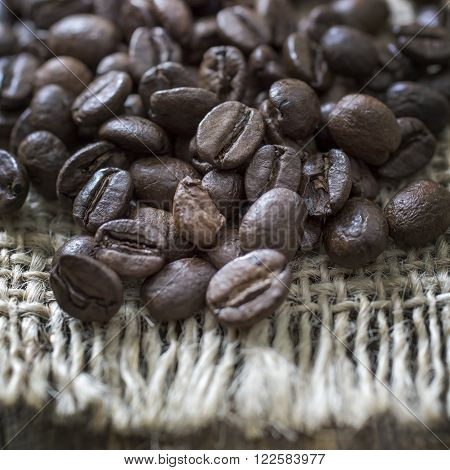 Close up of coffee beans in burlap sack