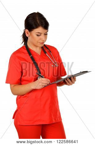 Young nurse standing on isolated background with a clipboard in her hand