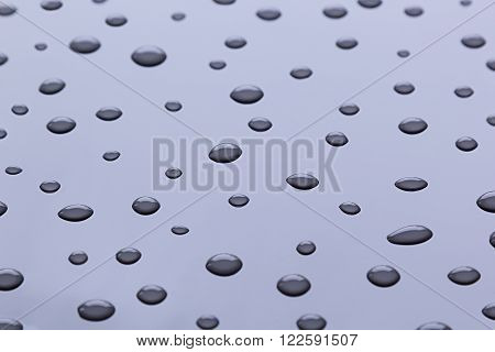 The drops of water on a blue background. The pattern.