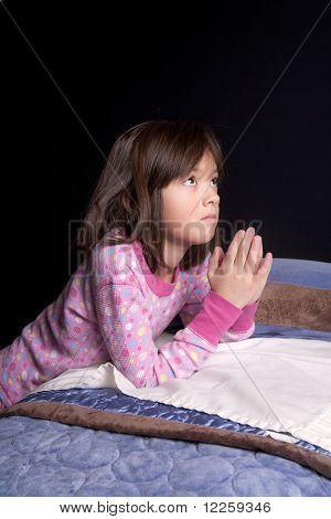 Saying prayers.