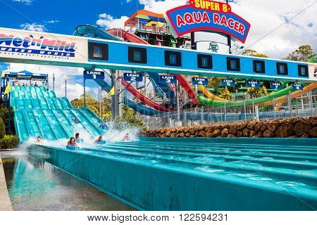 GOLD COAST, AUS - MAR 20 2016: Visitors riding on Super 8 Aqua Racer in Wet'n'Wild Gold Coast water park.