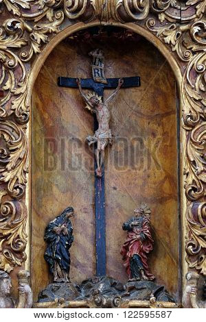 KOTARI, CROATIA - SEPTEMBER 16: Virgin Mary and Saint John under the cross, main altar in the church of Saint Leonard of Noblac in Kotari, Croatia on September 16, 2015.