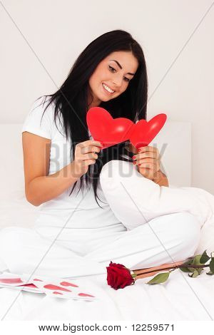 Beautiful Brunette Woman At Home Was A Gift From A Loved One, Ornament, Heart And Roses. Feast Day O