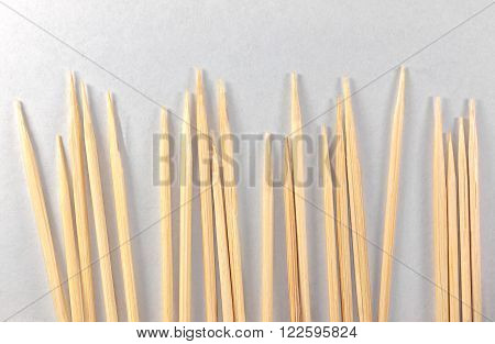 Toothpicks with shadows on a sheet of paper