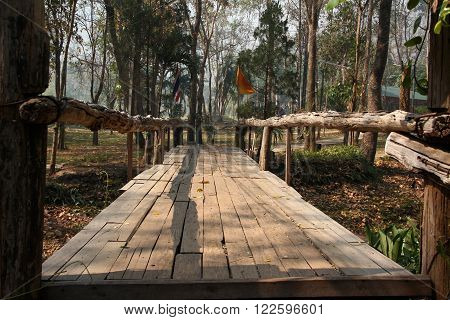 View of Wooden Bridge in Park in Buddhist monastery Wat Tam Wua Nothern Thailand.