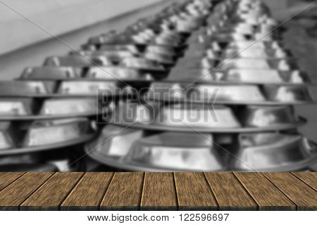 metal dishware for lunch of children in the school (blur background with wood table top for display or montage your product)