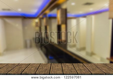 the interior modern design of public toilet (blur background with wood table top for display or montage your product)
