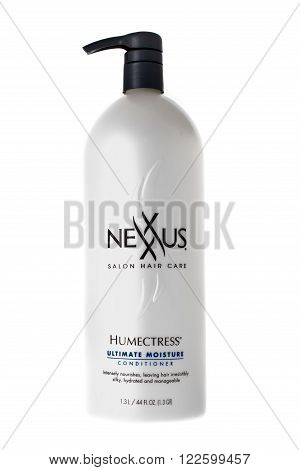 Winneconne WI - 9 April 2015: Bottle of Nexxus Salon Hair Care conditioner