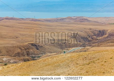 Sand and gravel hills and ravines in the mountain areas of Jordan. Desert mountain landscape