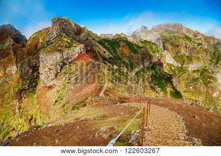 colorful volcanic mountain landscape with hiking path from Pico do Arieiro to Pico Ruivo Madeira Portugal