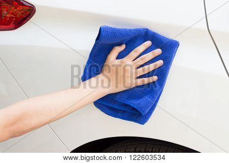 Concept of Woman cleaning car using microfiber cloth