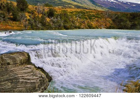 Magnificent powerful and high-water waterfall
