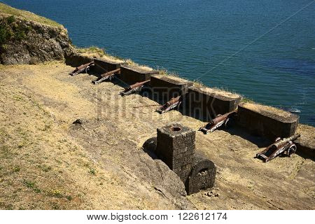 NIEBLA CHILE - FEBRUARY 2 2016: Cannons of the Niebla fort Chile on February 2 2016. The fort located at the mouth of the Valdivia river is part of the Valdivian fort system and was declared national monument in 1950.